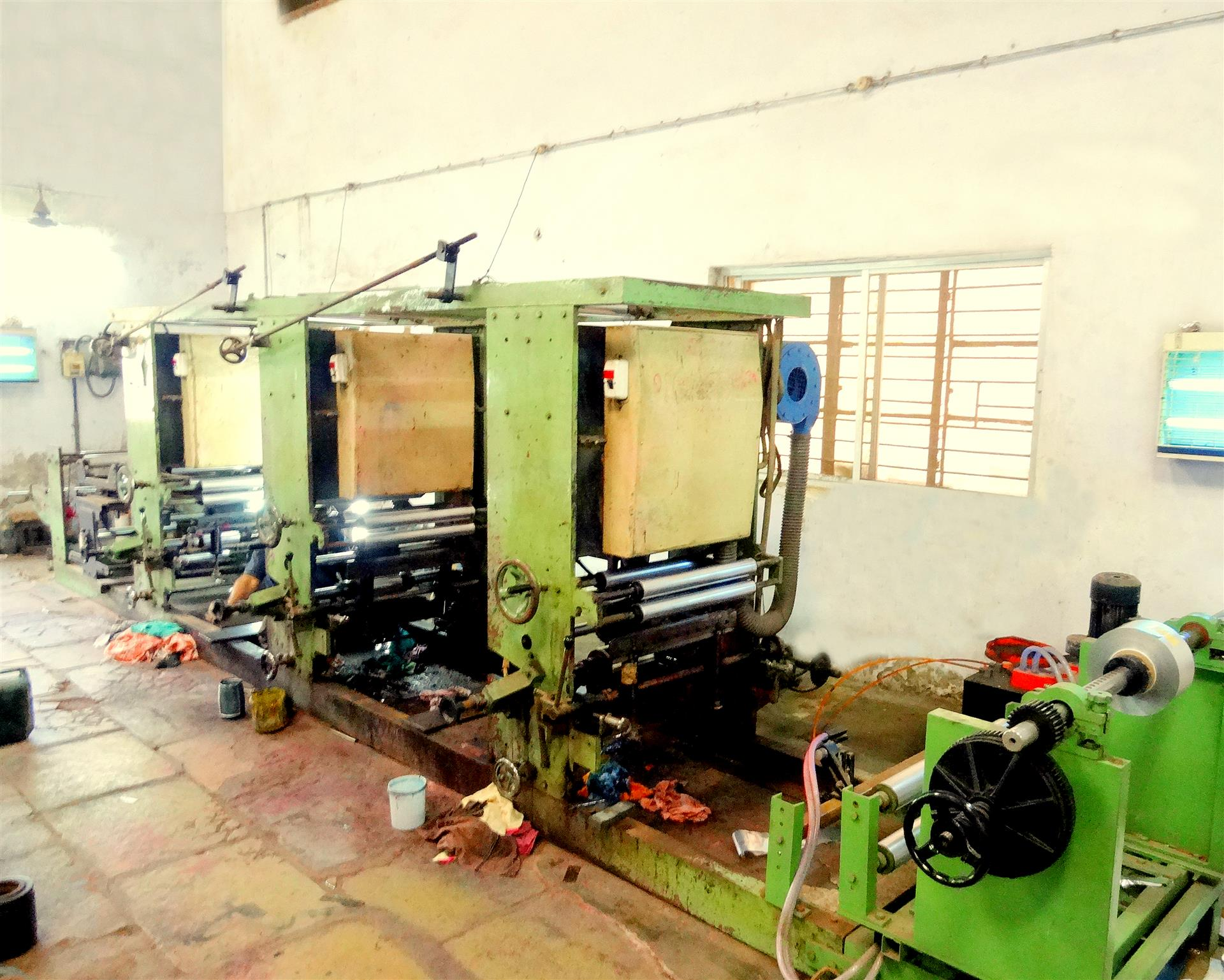 Image showing Three-Color Foil printing machine housed inside the Industrial Shed of Shree Krishna Enterprise