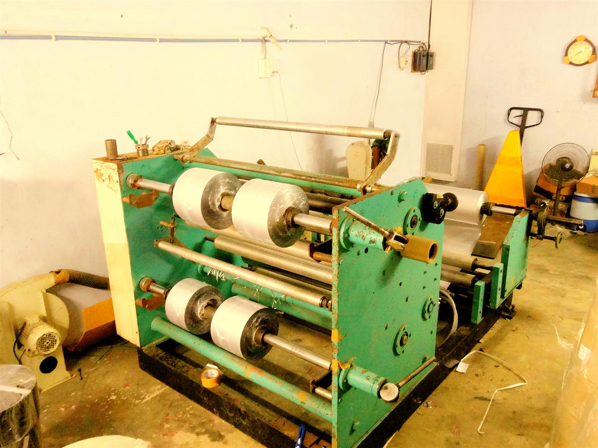 An image showing a foil slitting and rewinding machine housed inside the industrial shed of Shree Krishna Enterprise